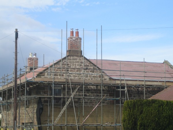 Pointed gable end and new chimneys